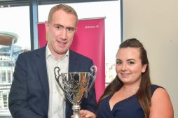 Ciaran McAlinney, from A & L Goodbody, Belfast (sponsors of the competition) presents the trophy to 2018 winner, Eimear Fanthorpe.