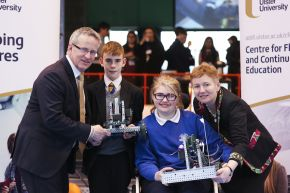 Pictured with their robots are Katie Douglas of Fleming Fulton School, Belfast and Nathan Mawhinney of Corpus Christi College, Belfast, alongside Ulster University Vice-Chancellor, Professor Paddy Nixon and Karen Hancock, Principal of Fleming Fulton School where the competition was held.