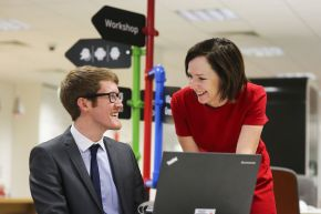 Ulster University graduate Mark Hutchinson has secured a graduate training position with PwC after taking part in a successful placement year. He is pictured with Director in Assurance at PwC, Orla MacAllister.