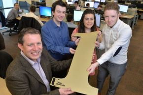 Nick Gray, Division Director at Liberty IT, winners of the over 50 employees category at last years awards, with Ulster University placement students, Ronan Burke, Orla Mooney and John Cronin-McCartney.