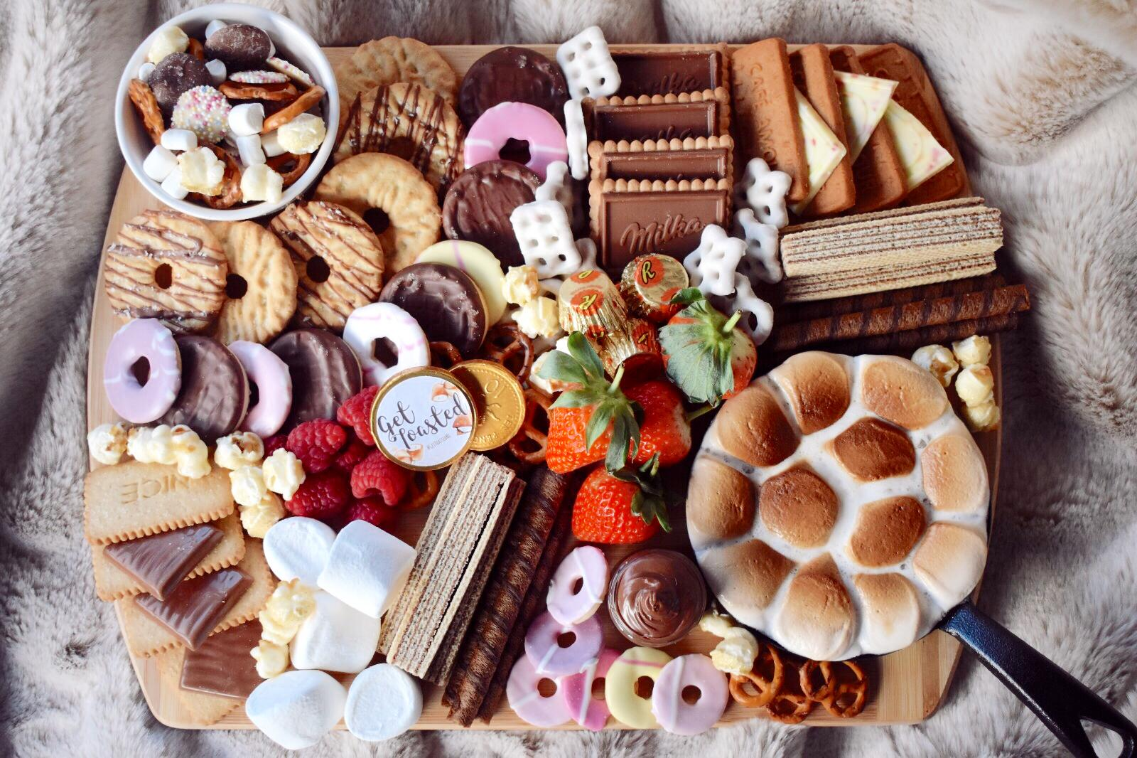 Full smore box including marshmallows, biscuits and chocolate.
