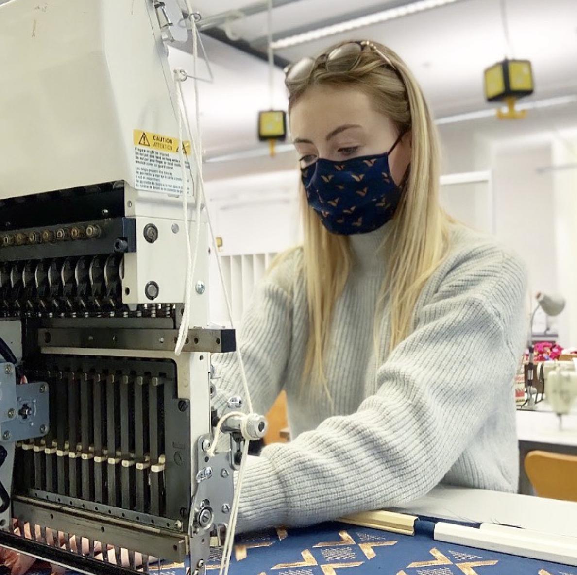 Robyn Elliot working on her sewing machine.