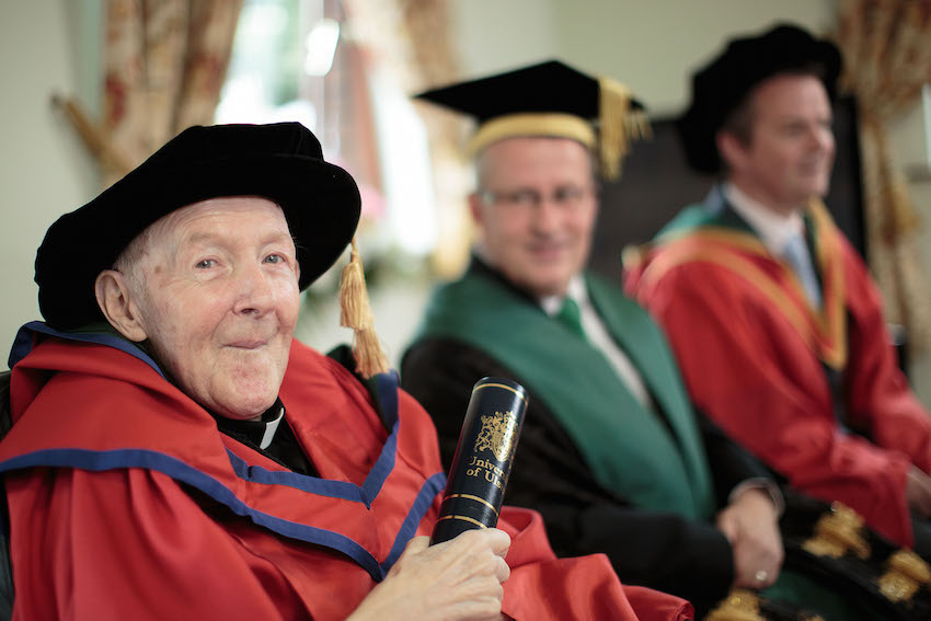 Father Harry Coyle awarded Ulster University honorary doctorate