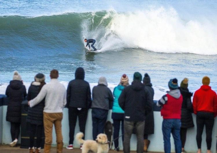 John surfing a wave.