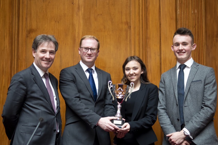 Cen Lowry and Cerys Kennedy, winners of the 2019 competition, being presented with the trophy by Coroner Mr Joe McCrisken, after the final in the Nisi Prius Court, RCJ.
