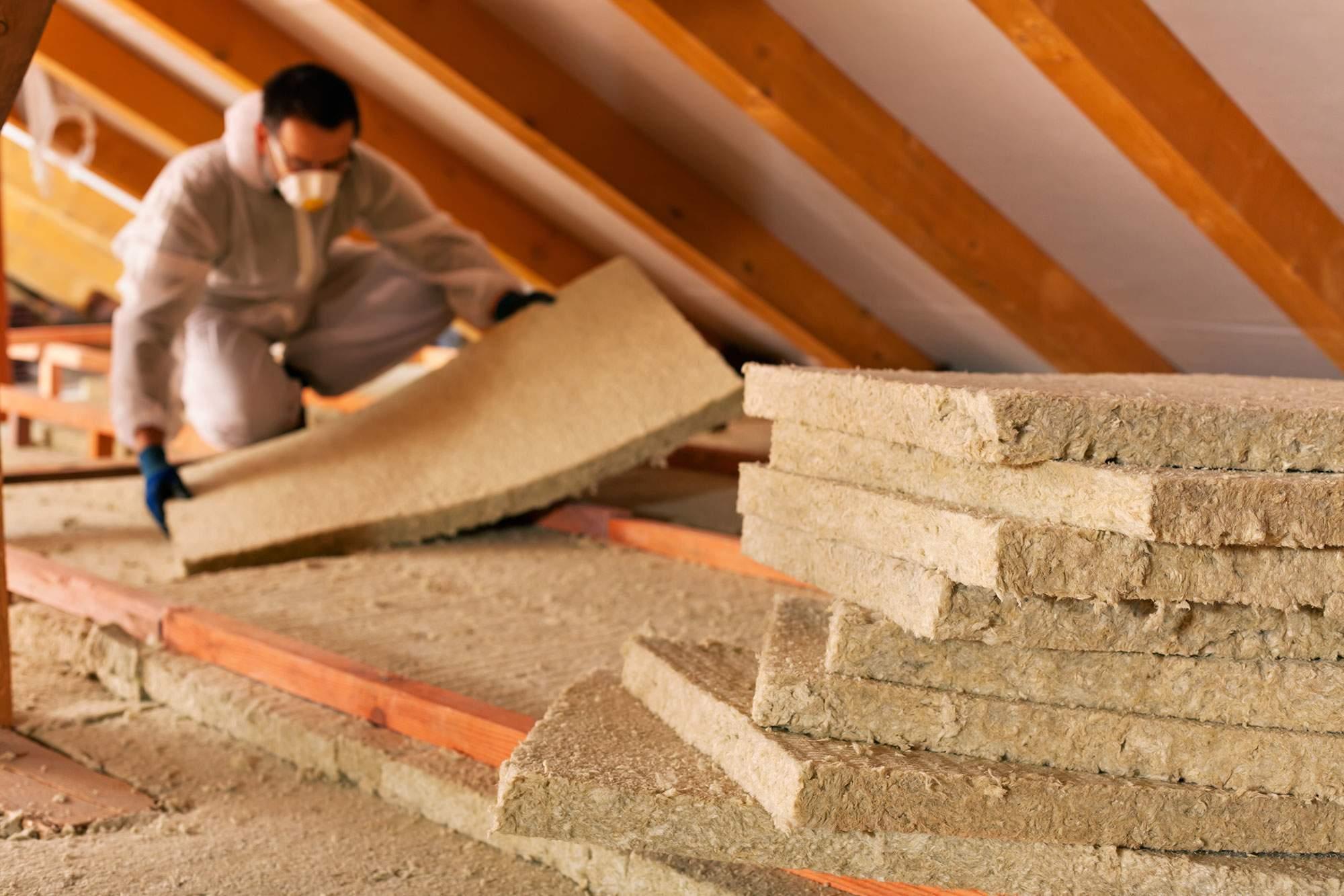 Man installing loft insulation