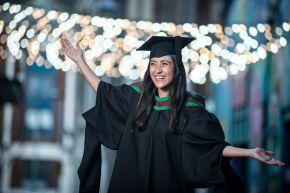 Inspirational international student graduates with distinction