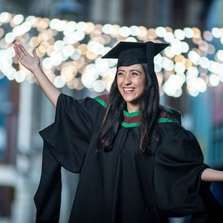 Inspirational international student graduates with distinction